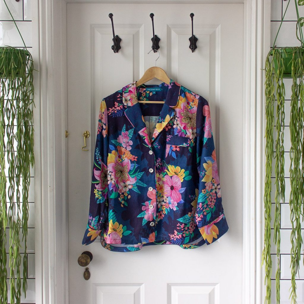 Orchard Moon Calypso Print shirt hanging on bathroom door